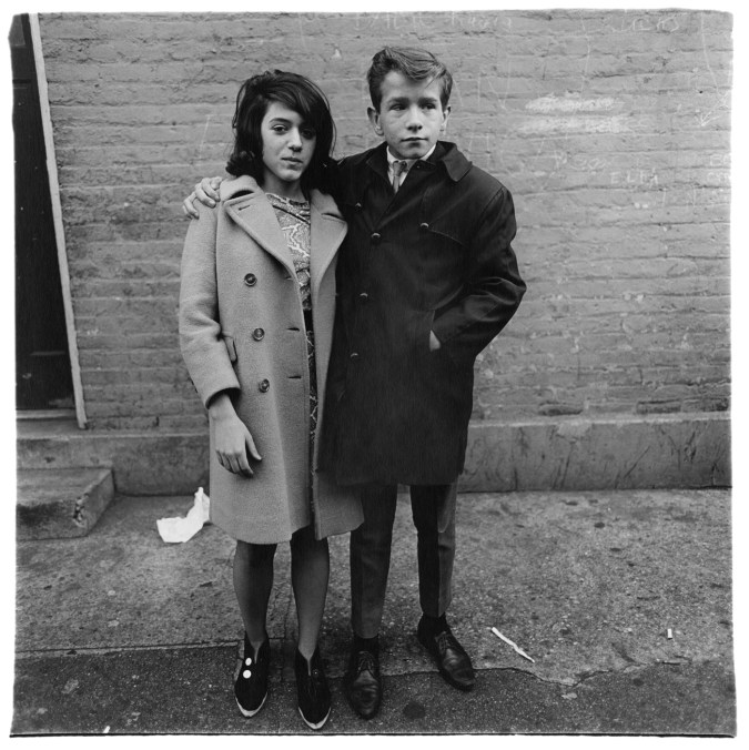Black-and-white photograph of a young man with his arm around a young woman