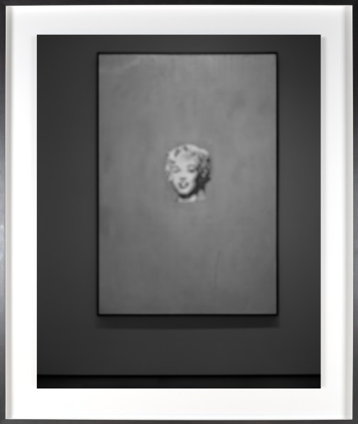 Black-and-white photograph of out of focus print of Marilyn Monroe's face