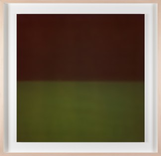 A framed photograph of a color field, top half is black, bottom half is forrest green