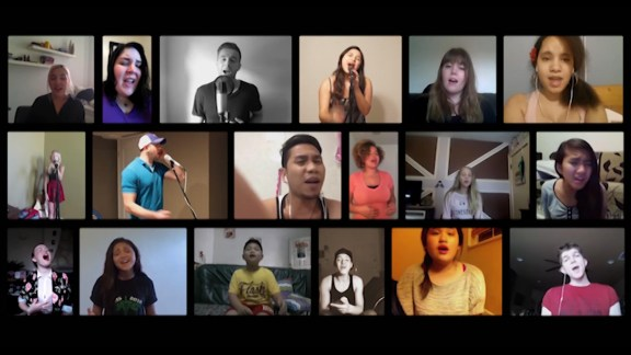 Composite image of 18 people, each alone in their space, singing the same song.