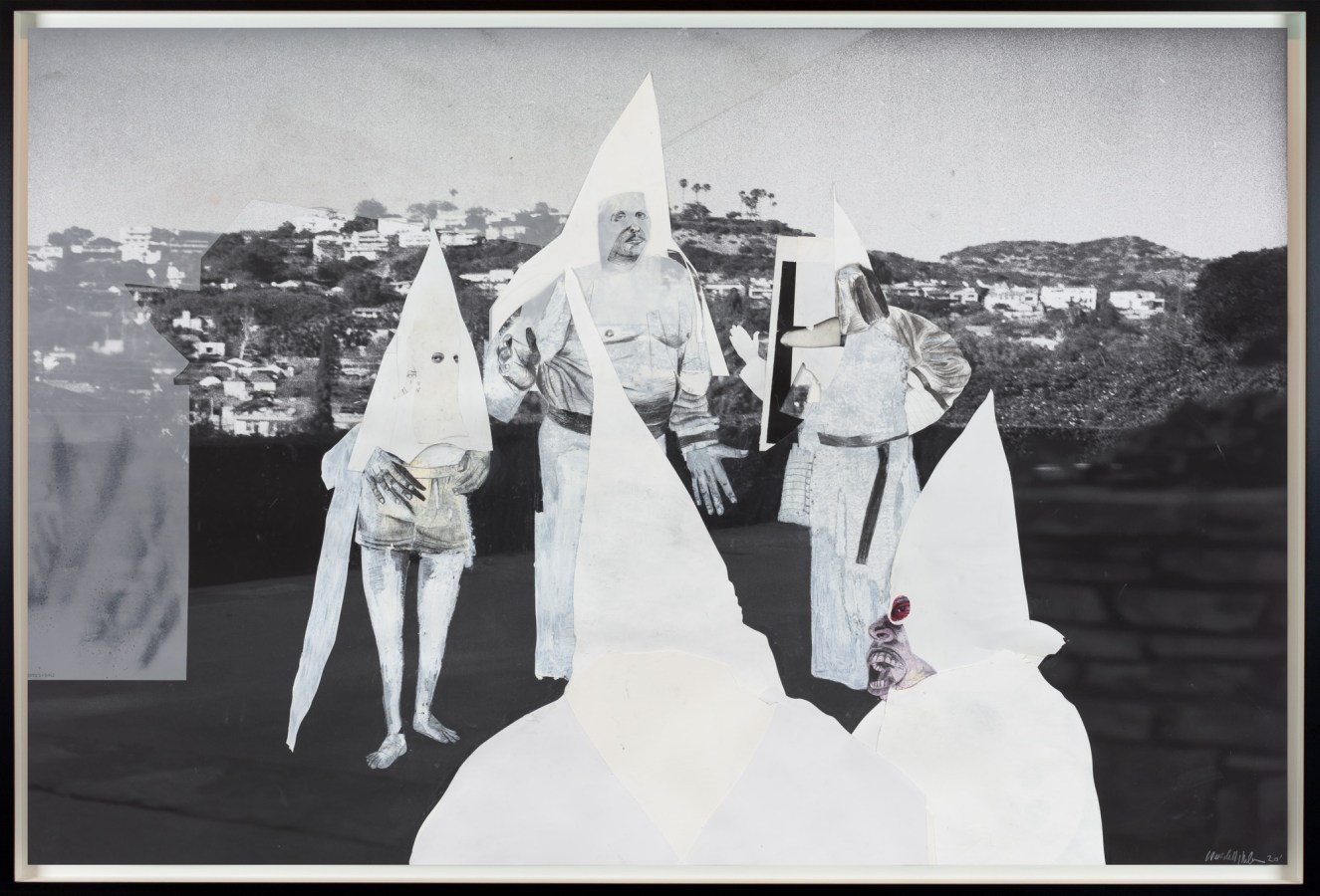 A black, white, and gray collage of five Klansmen in a circle. The background is the LA hills.