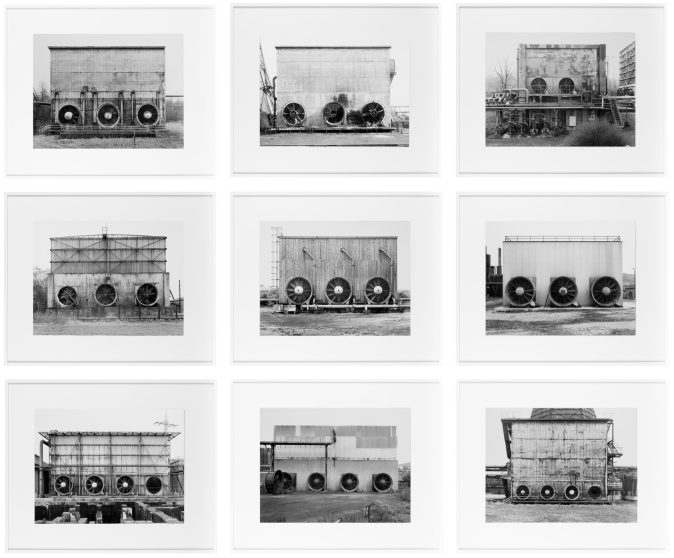 grid of nine framed black and white photographs of cooling towers