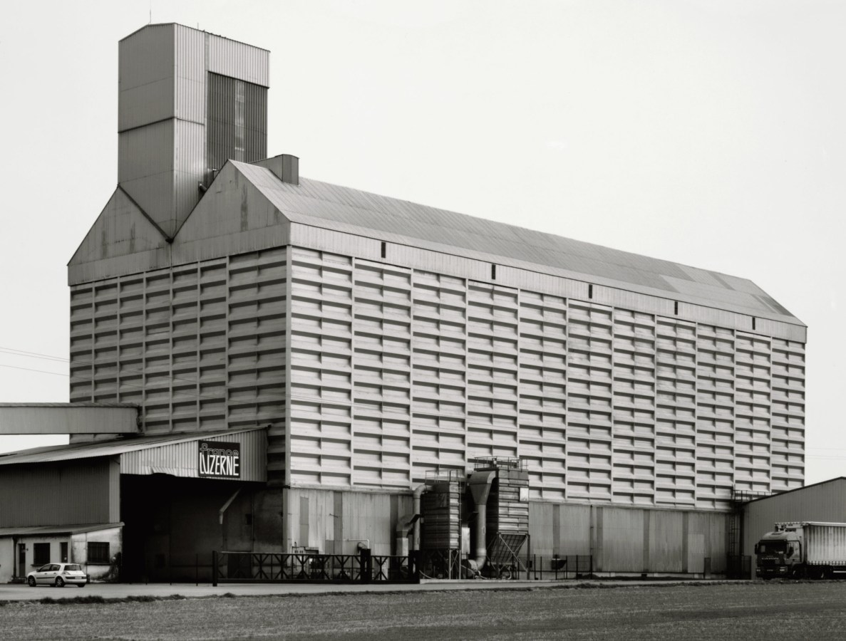 Black and white photograph of a large multi-storied grain elevator