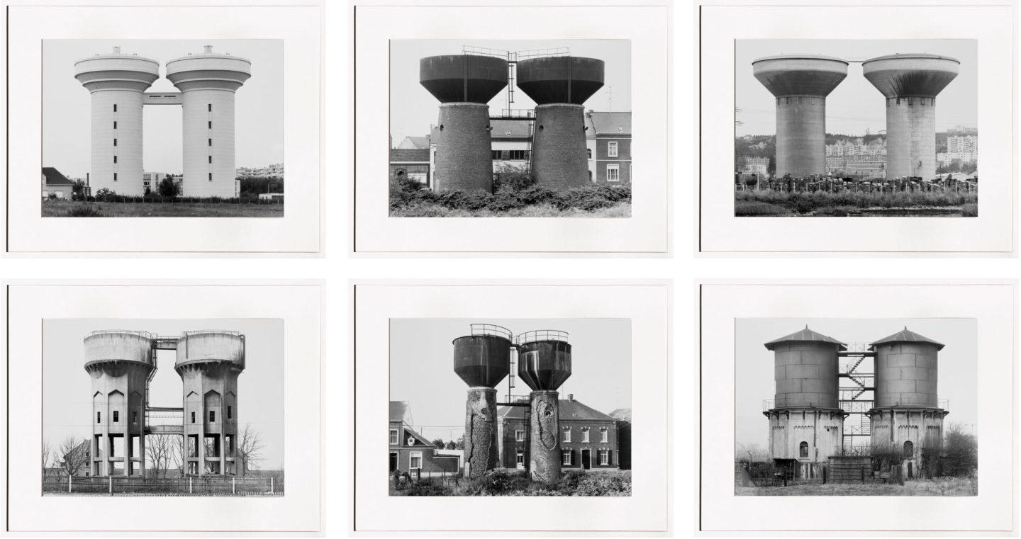 grid of six framed black and white photographs of water towers