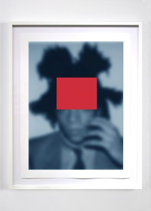 Blurred blue photograph of a man with a red rectangle superimposed on his face