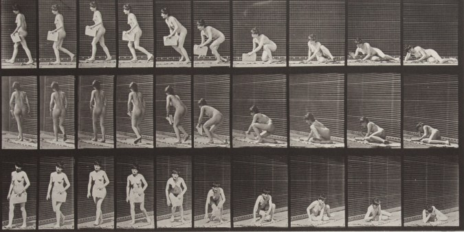 Sepia toned photograph with a grid of 30 panels showing a topless woman arising from the ground with a newspaper in her left hand; atypically, the sequence reads right to left.