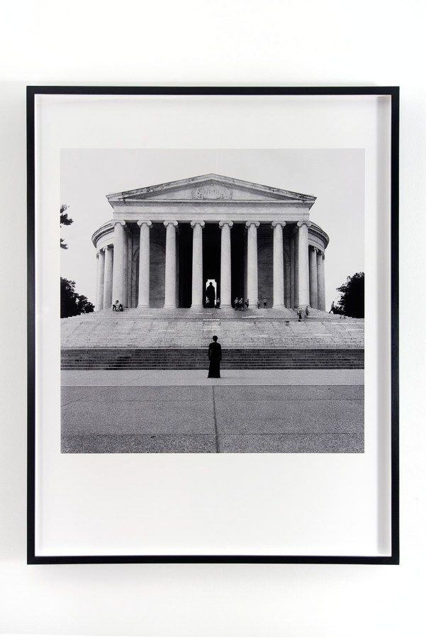 Black-and-white photograph of a solitary figure standing facing the Jefferson Memorial in Washington DC