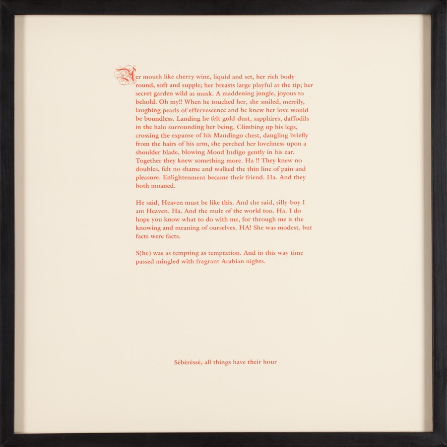Framed print of a block of red text on cream colored paper