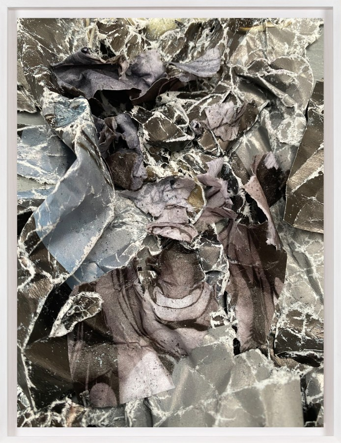 A framed collage of crumpled comic book images, with a screaming mouth at the center