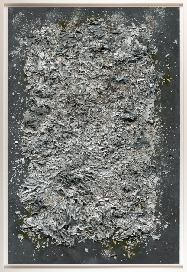 Framed black and white image of a pile of ash.