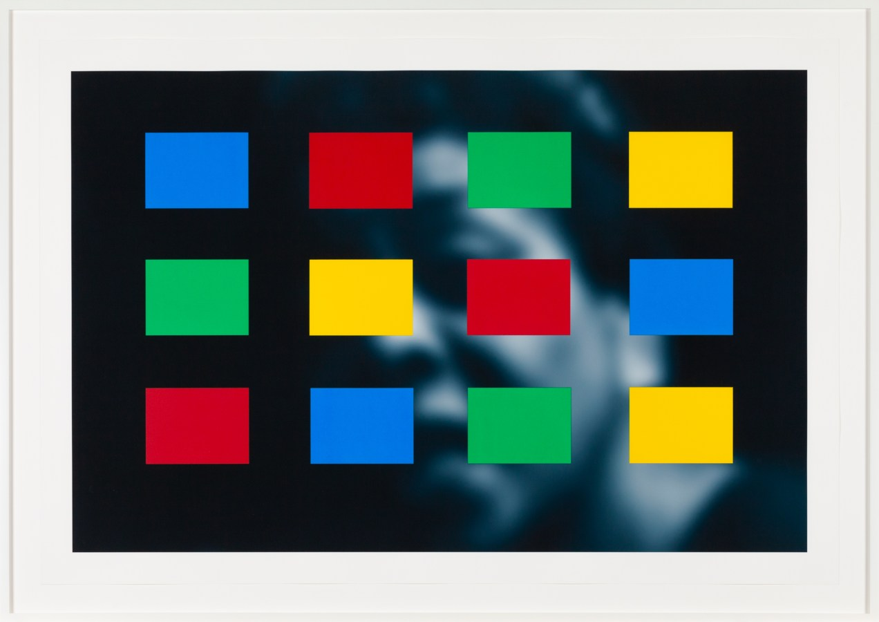 Framed artwork showing a soft-focus blue-toned portrait overlayed with blue, yellow, green, and red color blocks.