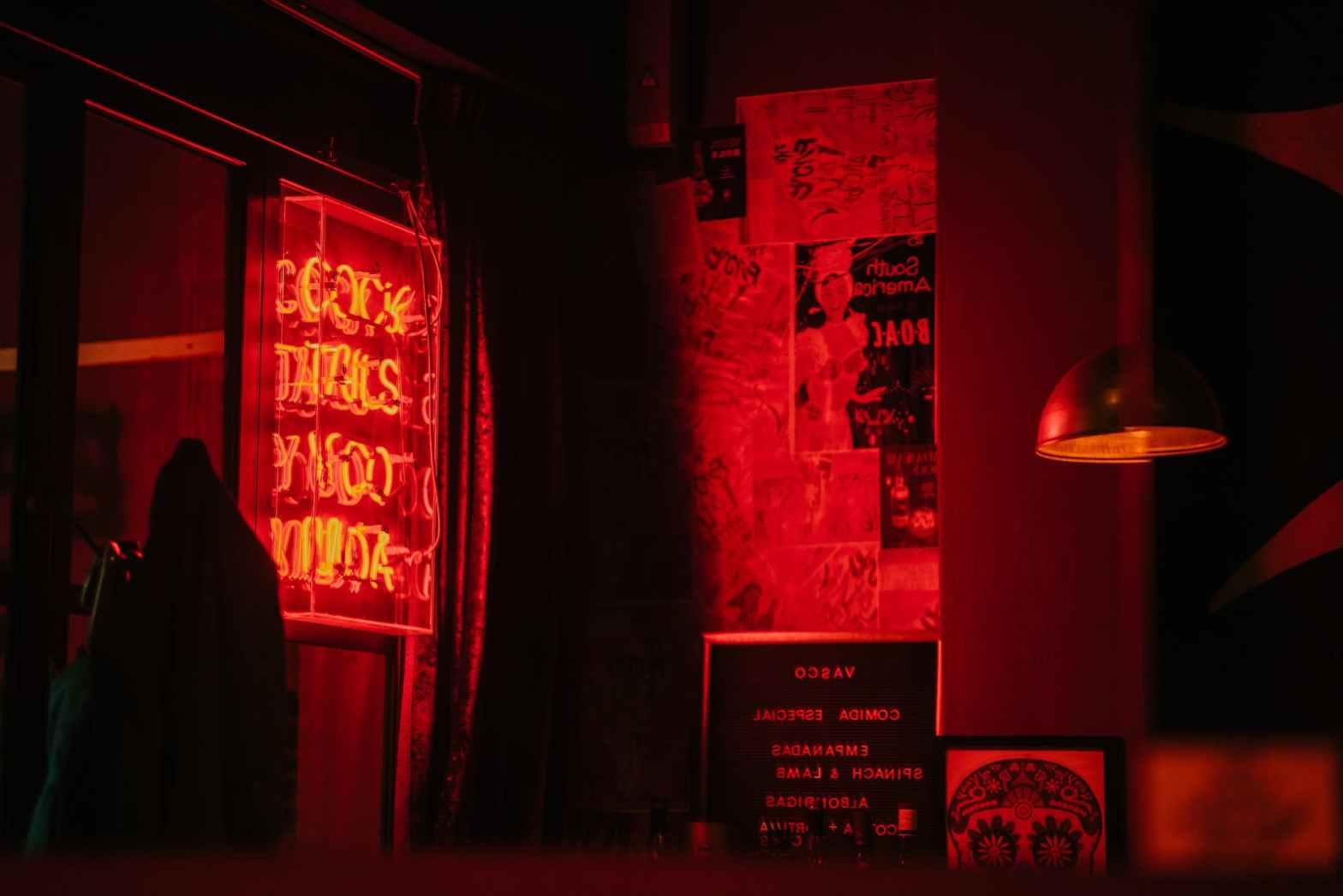 black frame under red pendant lamp