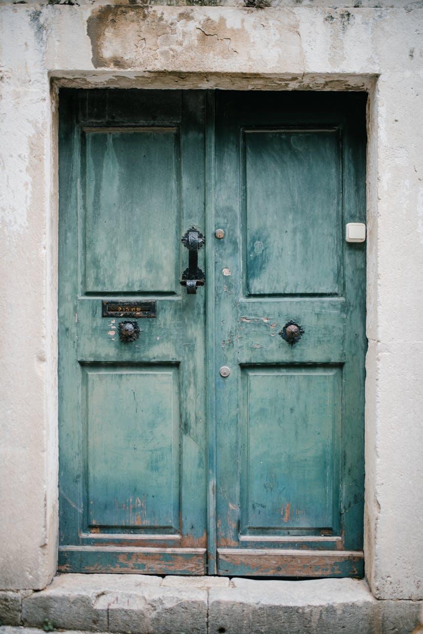vintage blue door of old building