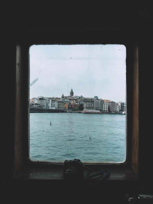 a view of an island city through a window