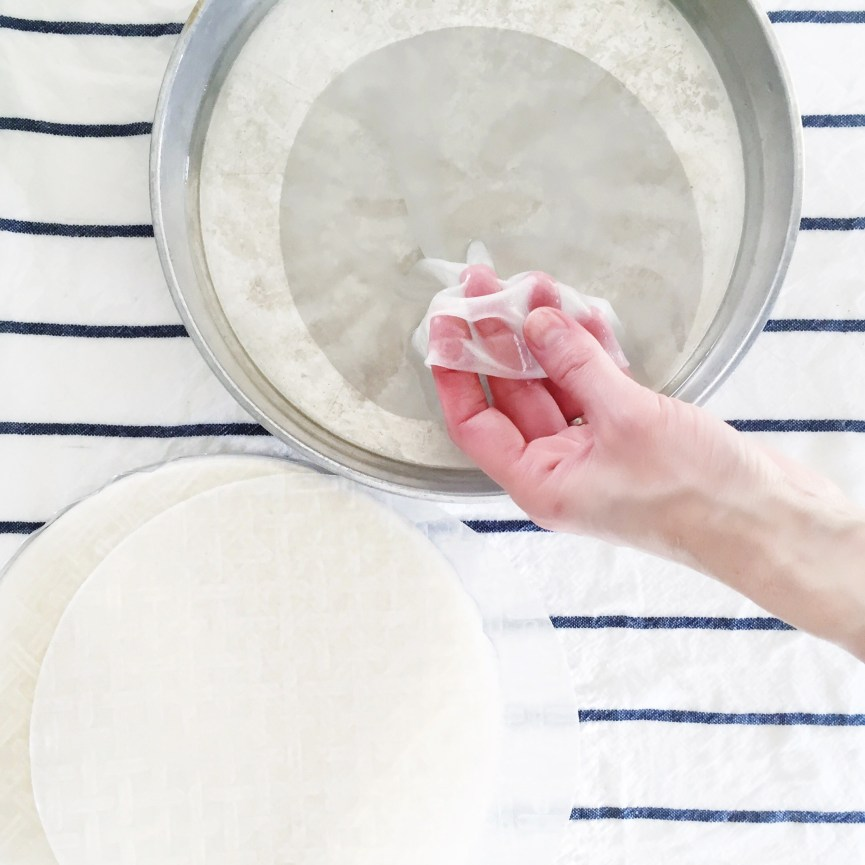 Preparing rice wrappers in warm water