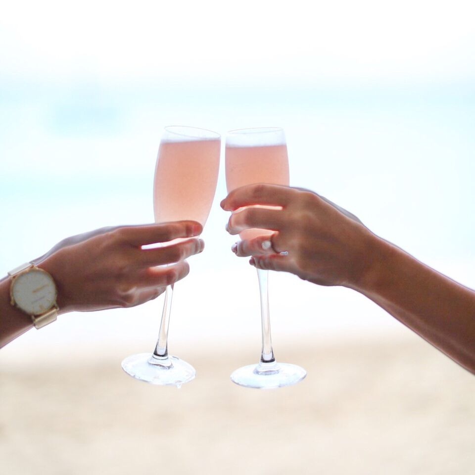 Fresh Guava Mimosas in champagne glasses