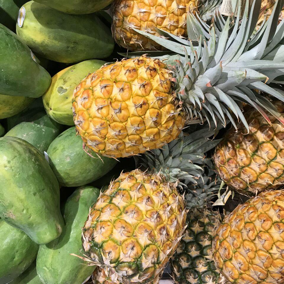 Fresh papaya and pineapple from the shores of O'ahu in Hawaii