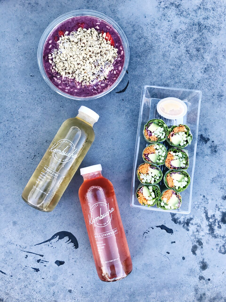 Lunch from Whole Foods in O'ahu complete with veggie spring rolls, acai bowl and kombucha