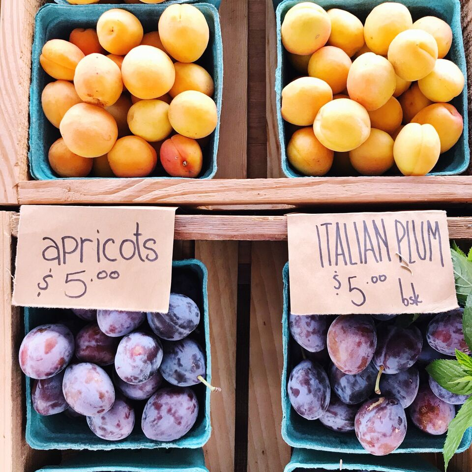 Apricots and Italian plums at the market