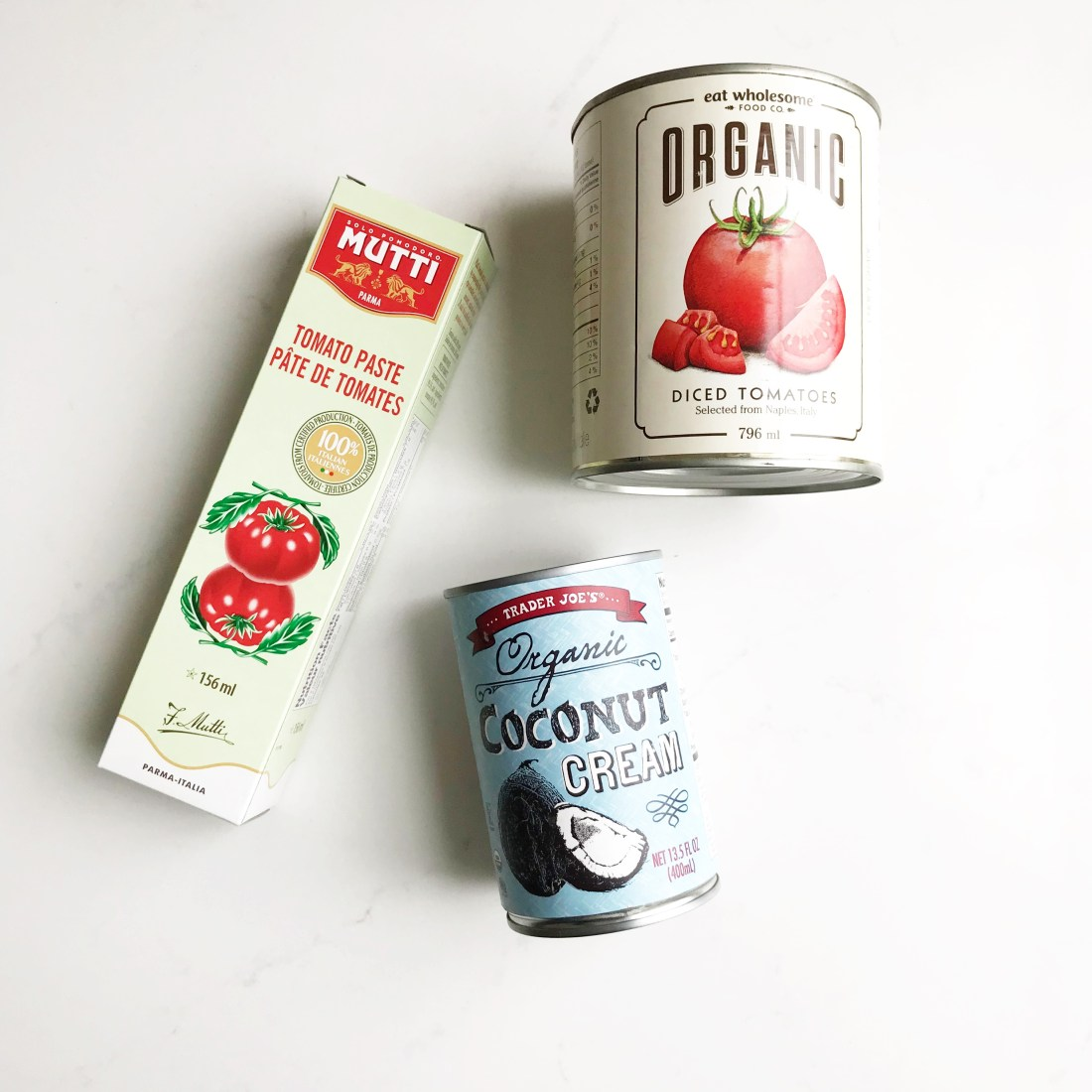 coconut cream, organic diced tomatoes and tomato paste: some of my must have condiments!