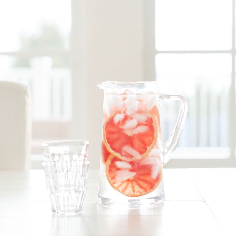 Pitcher of water with grapefruit. Dietitian's advice on 5 ways to improve your skin health with food.
