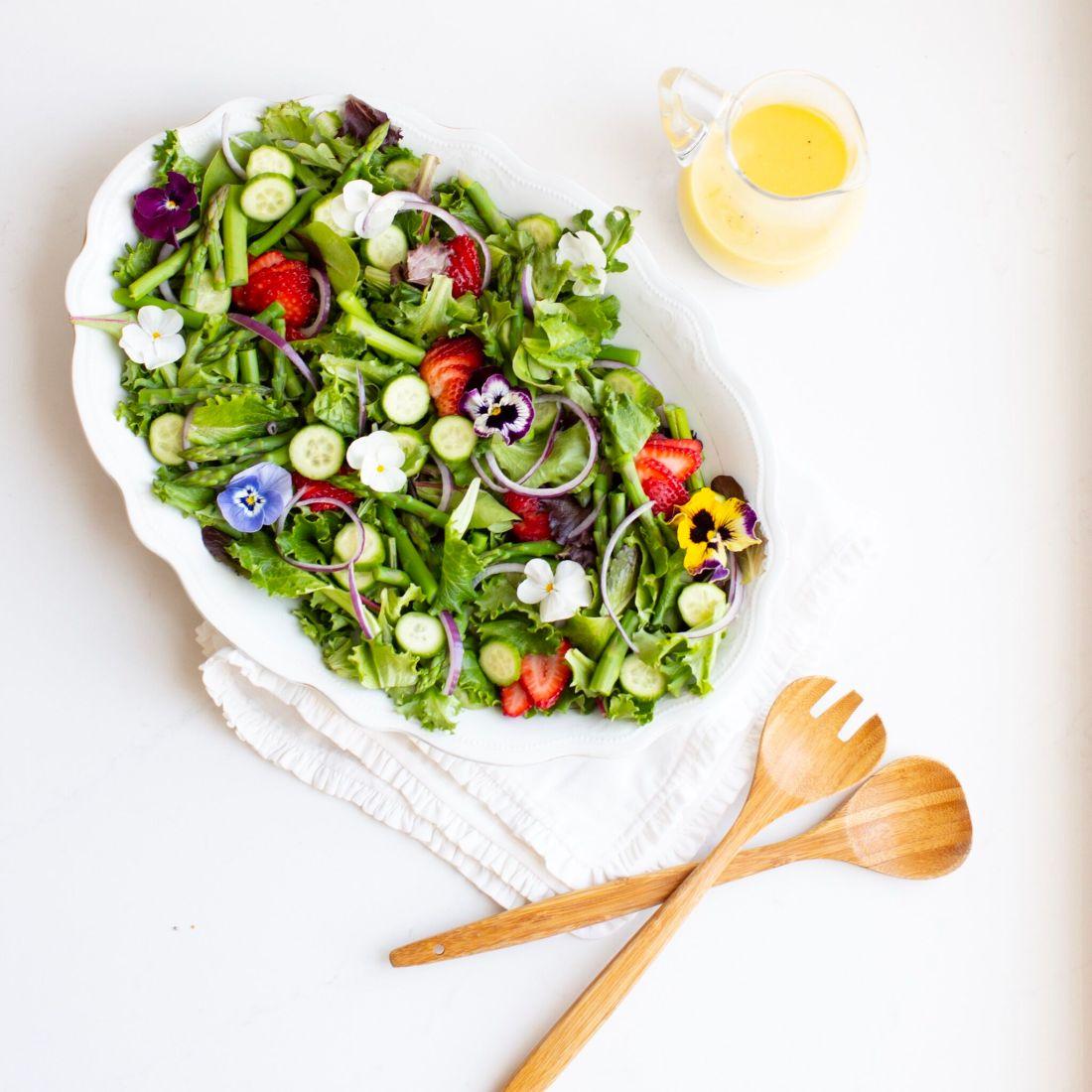 Spring Salad with edible flowers and creamy lemon vinaigrette.