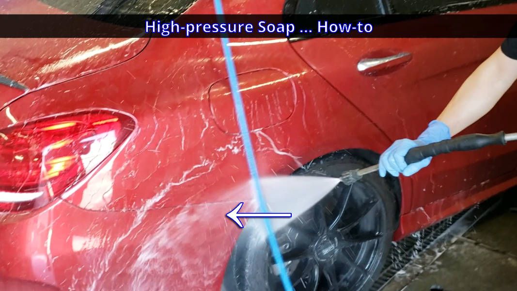 Using spray wand to wash between the bumper cover and rear fender of the car