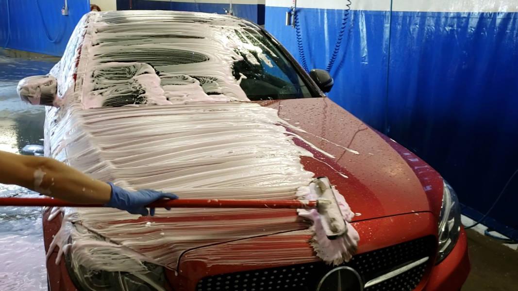 Using boar's hair foam brush to wash hood of Mercedes-Benz C450 C-Class