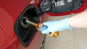 Adding fuel system cleaner to the fuel tank of a Mercedes-Benz