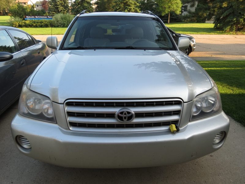 After Dr. ColorChip road rash chip repair on hood of a 2001 Toyota Highlander - Center