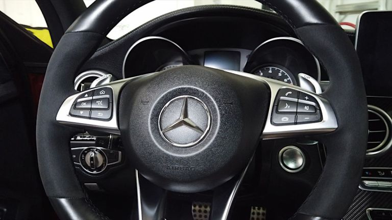 Newly cleaned and renewed steering wheel of a Mercedes-Benz C450 AMG Sport