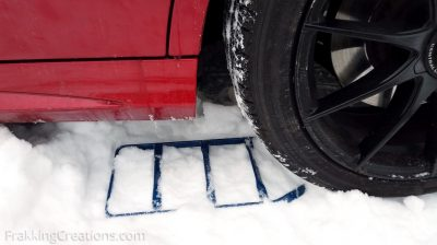 Using a traction pad to get unstuck from deep snow in the winter