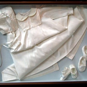 Christening gown in shadowbox.