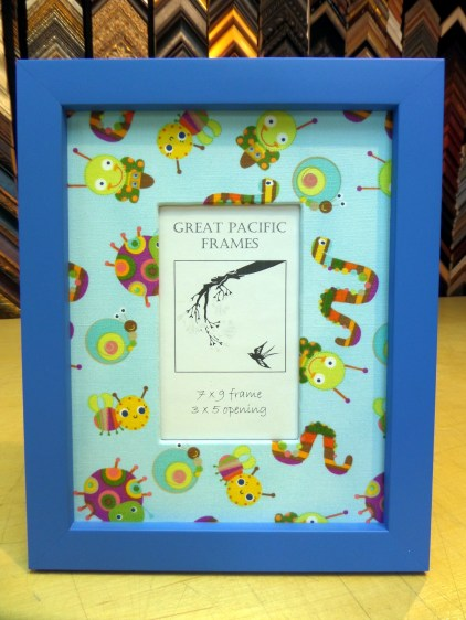 Blue frame with bug fabric.