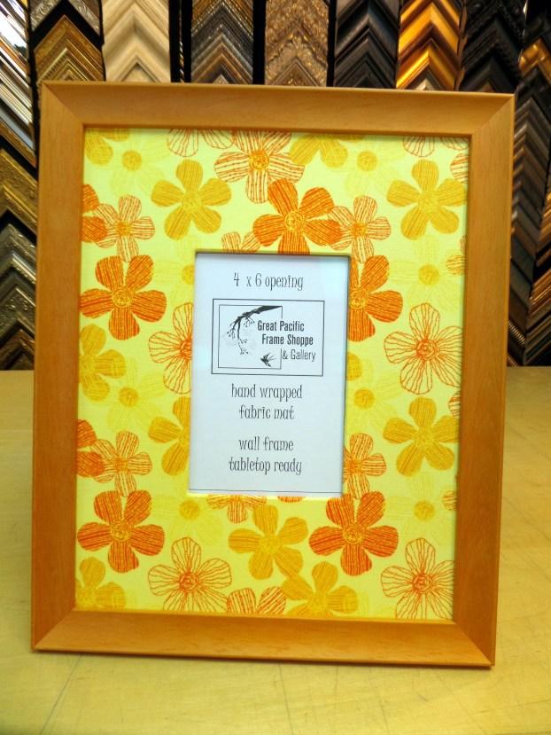 Orange frame with flower fabric.