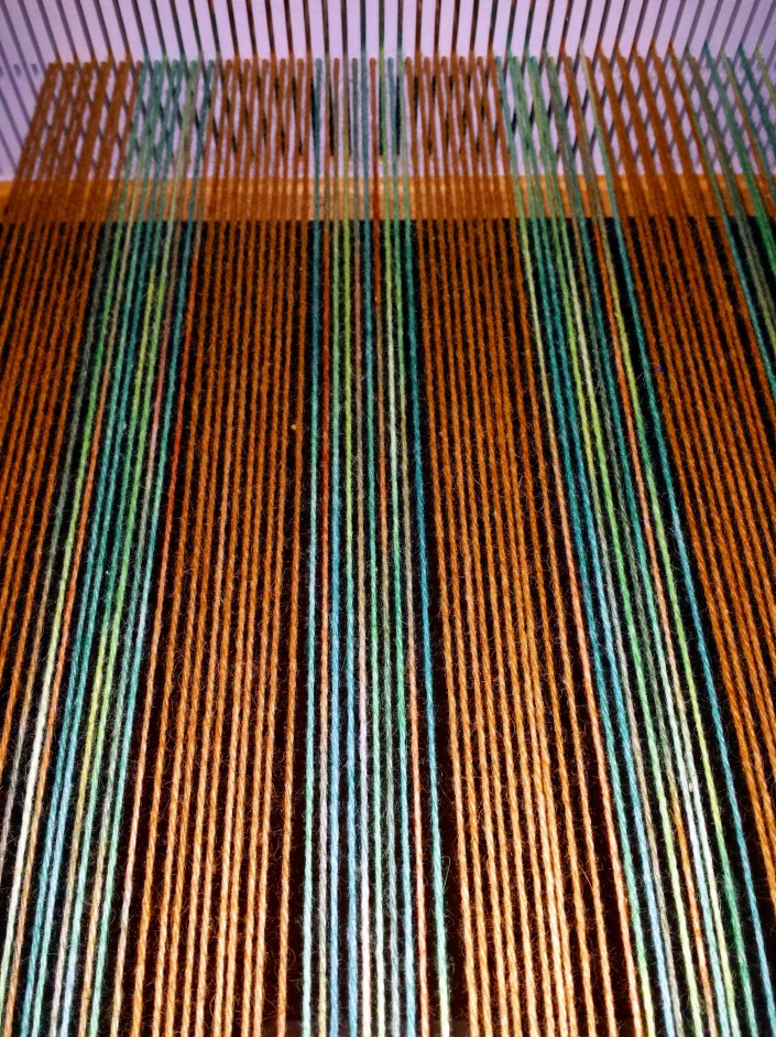 Warp Yarn - the vertical strands of weaving