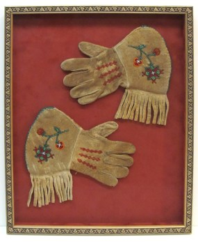 Framed embroidered antique leather gloves