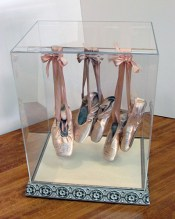 A beautiful custom display case for ballet slippers, made right here at The Frame & I, is a sweet display for a little girls' room!