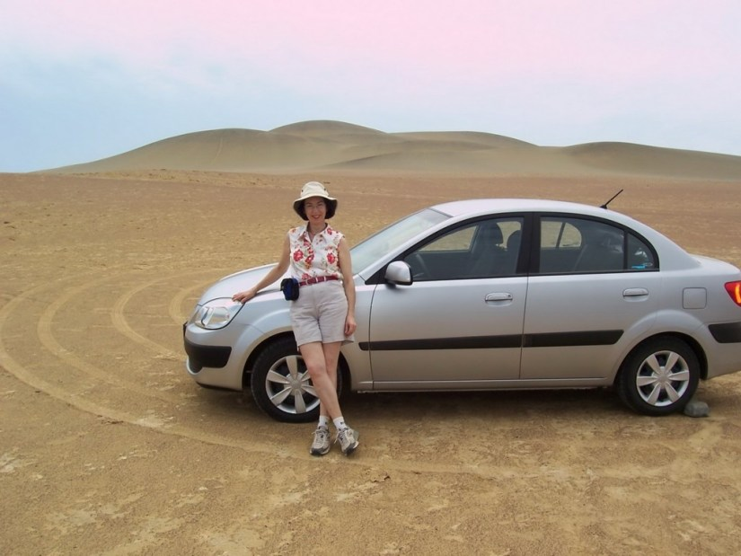 Jean beside rental car at Paracas National Reserve on the Paracas Peninsula, Ica, Peru.