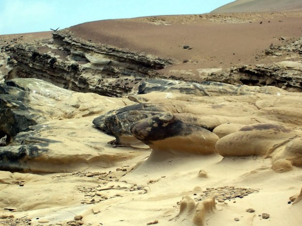 Sand formations on the Pacific coast at Paracas National Reserve, Ica, Peru.