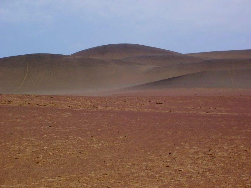 Brown burnt desert hills in Paracas National Reserve, Ica, Peru.