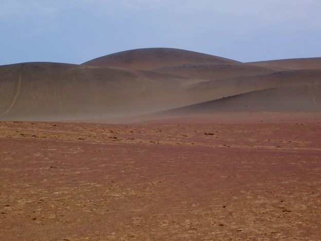 Brown burnt desert hills in Paracas National Reserve, Ica, Peru.