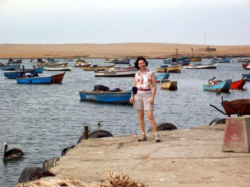 jean stands on Lagunillas wharf - national reserve of paracas - peru