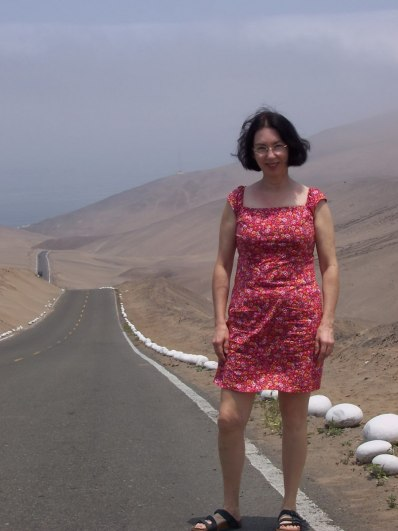 Jean standing along the Pan American Highway in Peru, South America