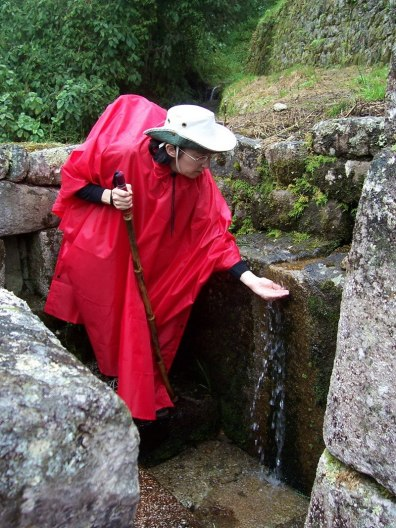 Jean gathers water at the stream in the Wiñay Wayna ruins in Peru, South America