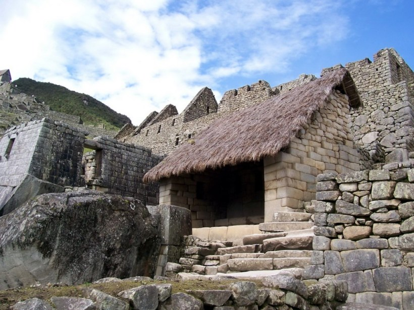 An image of a restored roofed building at Machu Picchu in Urubamba Province, Peru.