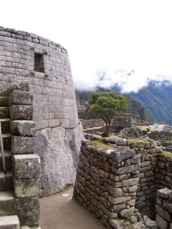 An image of the stone wall of the Tower of the Sun at Machu Picchu in Urubamba Province, Peru.