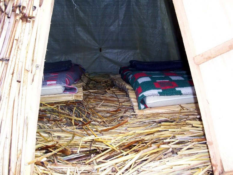 beds inside reed tents, floating island, lake titicaca