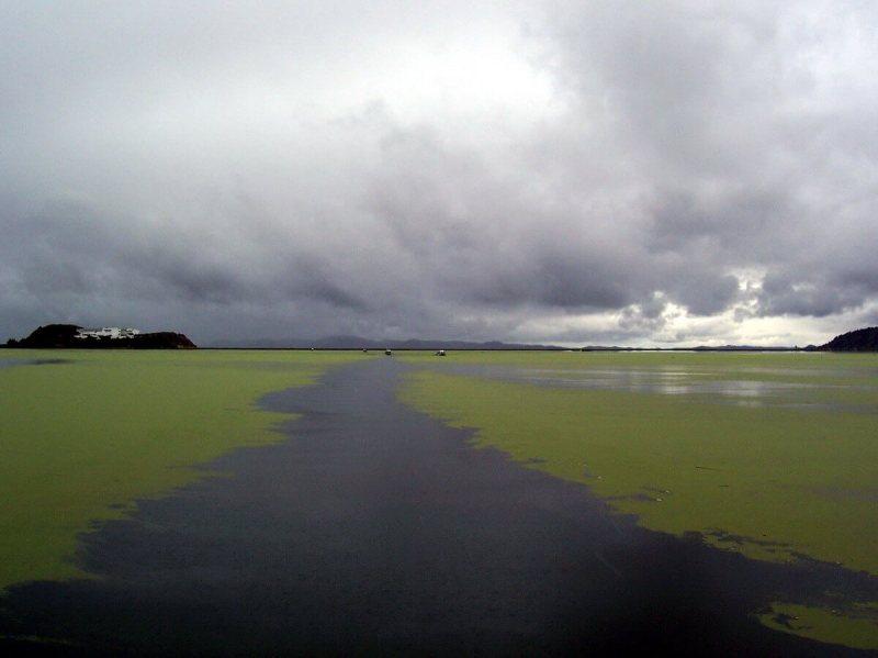 storm clouds over lake titicaca, peru