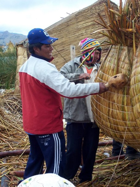 uros men build reed boat, floating island, lake titicaca, peru 2